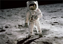 Neil Armstrong and Buzz Aldrin walk on the Moon.